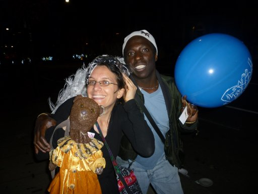nightime photo of Bearsac with Debra and man with balloon