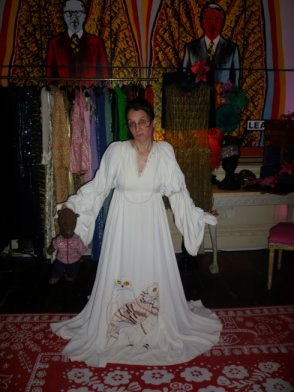 photo of Debra in extremely long dress holing Bearsac at My Dailey.co.uk alunch party