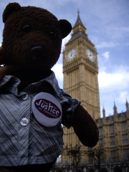 photo of bearsac wearing jews for justice for palestinians badge with st stephen's tower in background