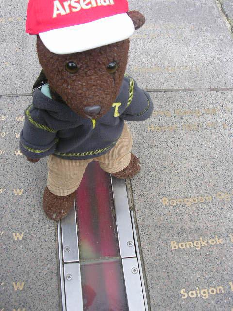 photo of bearsac standing on the prime meridian line greenwich